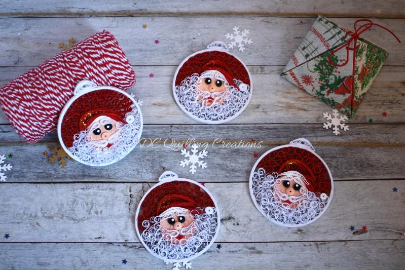 addobbi natalizi fai da te palline con Babbo Natale in filigrana di carta